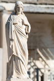 Statue of Jesus sitting Stock Photo