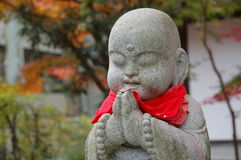 Statue of Jizo, Japan. A statue of Jizo, the Buddhist child monk protector of children, travelers and women, Japan Royalty Free Stock Images