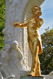 The statue of Johann Strauss. Park in Vienna.  Elegant gilded statue of Johann Strauss, playing the violin in white marble arch Stock Photography