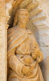 Statue of John the Apostle. Statue of Saint John the Apostle, depicted with a chalice and a snake, part of the 16th Century Principal Gate at the Church of Santo Royalty Free Stock Photo