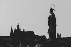 Statue of John of Nepomuk silhouette at Charles Bridge. Prague, Royalty Free Stock Images