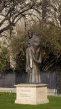 Poitrait view of the Statue of John Paul II. Statue of John Paul II in the garden next to the Cathedral of Notre Dame in Paris, France Royalty Free Stock Photos