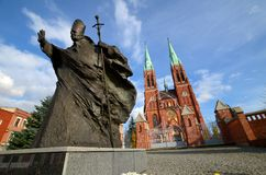 Statue of John Paul II Rybnik, Poland. Statue of John Paul II against the background of the cathedral Rybnik, Poland Stock Image