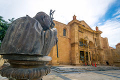 Statue of John Paul the second in front of the oldest cathedral in Americas, Santa Maria la Menor, Santo Domingo.  Royalty Free Stock Images