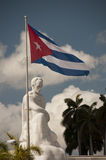 Statue of Jose Marti and cuban flag Royalty Free Stock Photography