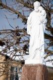 A statue of Joseph carrying Jesus Stock Photo