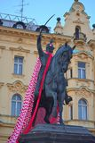 Statue of Josip Ban Jelacic on the horse with Croatian flag. On the main square in Croatian capital city of Zagreb.The statue is flagged in honor of the vice stock image