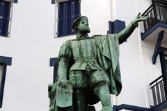 Statue of Juan Sebastian de Elcano in the port of Getaria, Basque Country stock photography