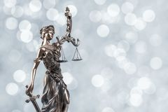Statue of justice on Bokeh background stock photos