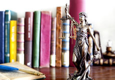 Statue of justice. And books stock image