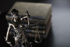 Jugde concept. Statue of justice and books in judge office stock images