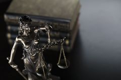 Jugde concept. Statue of justice and books in judge office stock photo