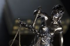 Jugde concept. Statue of justice and books in judge office royalty free stock image