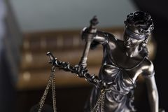 Jugde concept. Statue of justice and books in judge office stock photos