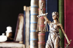 Statue of justice and books royalty free stock photography
