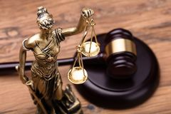 Statue Of Justice With Brown Gavel. On Wooden Table stock images