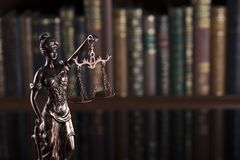 Law theme – court library. Statue of justice in the court library Stock Photo