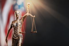 Statue of justice on flag background. Courthouse courtroom investigate justice legal rights stock image