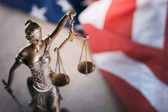 Statue of justice on flag background. Courthouse courtroom investigate justice legal rights royalty free stock photography