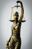 Statue of Justice. Focus is on scales stock images