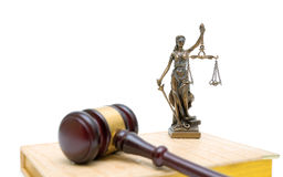 Statue of justice, gavel and book on white background Royalty Free Stock Photography