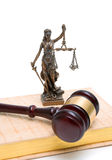 Statue of justice, gavel and book on white background Stock Images