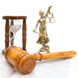 Statue of justice, gavel, law book and hourglass Stock Photo