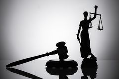 Statue Of Justice And Gavel. On Reflective Background stock images