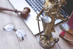 Statue of justice, judge gavel and laptop. stock photos