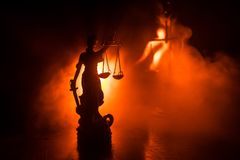 The Statue of Justice - lady justice or Iustitia / Justitia the Roman goddess of Justice on a dark fire background stock photography
