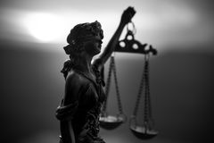 The Statue of Justice - lady justice or Iustitia / Justitia the Roman goddess of Justice on a dark fire background. The Statue of Justice - lady justice or stock image