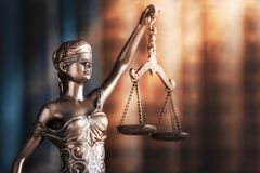 Statue of justice on library background. Courthouse legal antique authority background balance royalty free stock photos