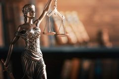 Statue of justice on library background. Law lawyer background concept hammer judge Stock Photos
