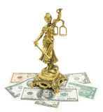 Statue of justice and money on white background. Statue of justice and money isolated on white background close-up royalty free stock photography