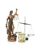 Statue of justice and money on a white background. vertical phot Royalty Free Stock Image