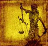 Statue of justice on old paper background Royalty Free Stock Images