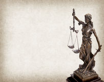 Statue of justice on old paper background Stock Photos