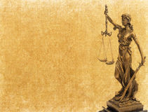 Statue of justice on old paper background Stock Image