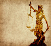Statue of justice on old paper background Stock Photo