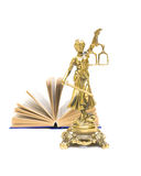 Statue of justice and open book isolated on white background Stock Image