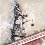 The statue of Justice stands on the roof of the Gengenbach town hall stock image