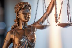 Statue of Justice with scales in lawyer office. Legal law, advice and justice concept stock photo