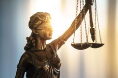 Statue of Justice with scales in lawyer office. Legal law, advice and justice concept stock image