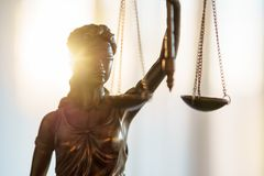 Statue of Justice with scales in lawyer office. Legal law, advice and justice concept royalty free stock images