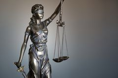 Statue of Justice with scales in lawyer office. Legal law, advice and justice concept royalty free stock photography