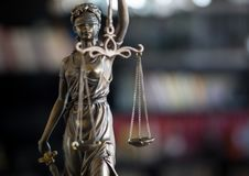 Statue of Justice with scales in lawyer office. Legal law, advice and justice concept royalty free stock photo