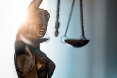 Statue of Justice with scales in lawyer office. Legal law, advice and justice concept stock images