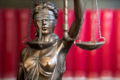 Statue of Justice with scales in lawyer office. Legal law, advice and justice concept stock photos
