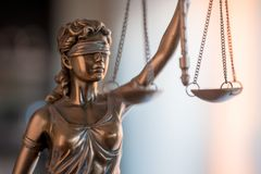 Statue of Justice with scales in lawyer office. Legal law, advice and justice concept stock photography