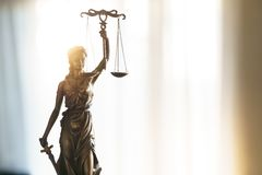 Statue of Justice with scales in lawyer office. Legal law, advice and justice concept royalty free stock photos